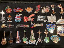 HUGE Hard Rock Cafe Beatles Anthology Springsteen 70+ pin lot withcollectors bag