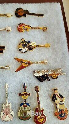 Hard Rock Cafe Lot Of 61 Guitar & Badge Pins In Hinged Frame Vegas Sydney Lisbon